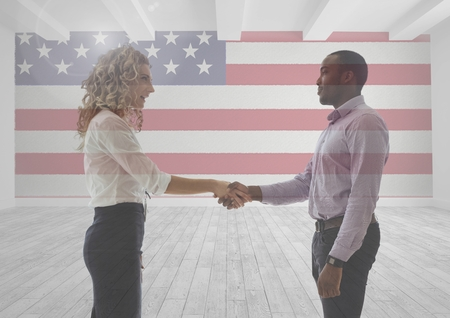 extending: Digital composite of Business people shaking their hands against american flag