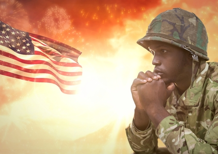 Digital composite of Military thinking against sunset and american flag Stock Photo
