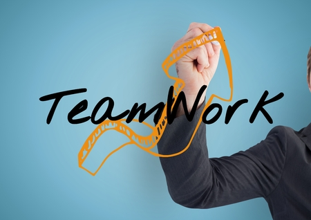 Digital composite of Businessman hand finishing the arrow of the graphic about TEAM WORK
