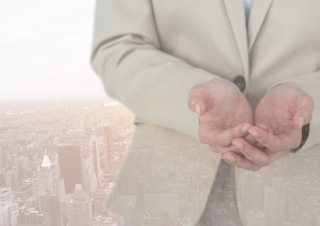 humility: Digital composite of Part of business man against city Stock Photo