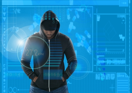 Digital composite of hacker with arms in pocket in front of blue digital background