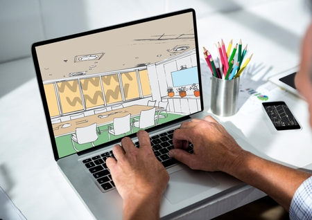 amusing: Digital composite of businessman hands on laptop. On the screen office lines ( color: green, blue and beige)