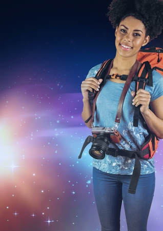 stealer: Digital composite of Smiling photographer with a backpack against galaxy background Stock Photo