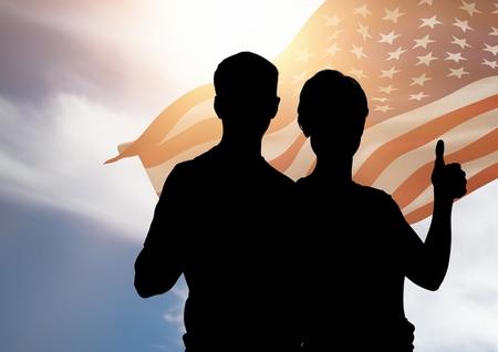Digital composite of Couple silhouette against american flag Banco de Imagens