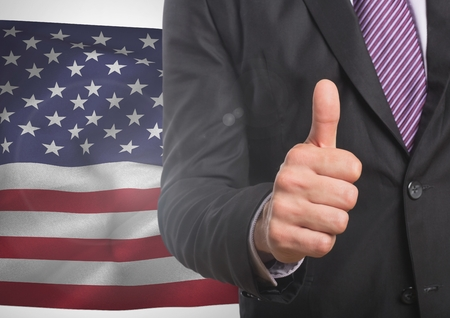 five star: Digital composite of Business man with thumb up against american flag