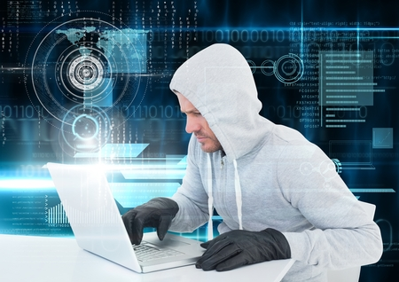 Digital composite of Hacker with glove using a laptop in front of digital background
