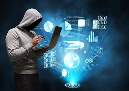 Digital composite of Hacker working on laptop in front of digital graphics on background
