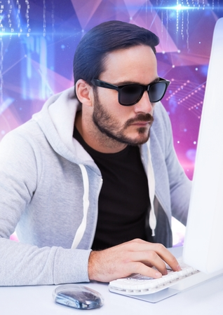 frown: Digital composite of hacker with sunglasses typing on a keyboard in front of digital background Stock Photo