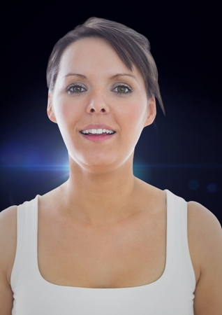 Digital composite of Woman in tank top against blue flare Stock Photo