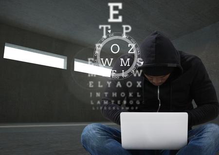 Digital composite of Hacker working on laptop in dark room behind digital scriptures Stock Photo - 81014835