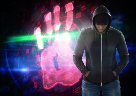Digital composite of Hacker in front of digital background Stock Photo