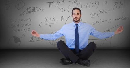 meditation man: Digital composite of Business man meditating in grey room with math doodles