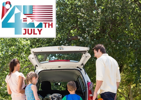 Digital composite of Family putting stuffs in boot for independence day Stock Photo