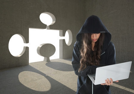 crime solving: Digital composite of Woman hacker working on laptop in front of background with a 3D puzzle hole