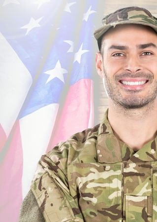 Digital composite of Smiling soldier in front of american flag