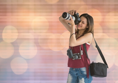 Digital composite of photographer taking a photo. blue and orange blurred lights Stock Photo