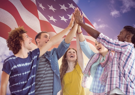 Digital composite of American Flag with young people high five hands together