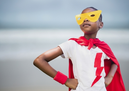 Digital composite of Girl superhero against blurry beach