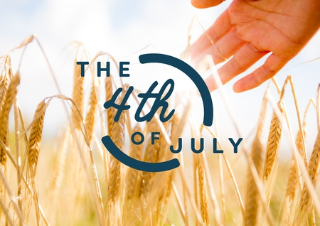 touch sensitive: Digital composite of Blue fourth of July graphic against hand touching grain and flare Stock Photo