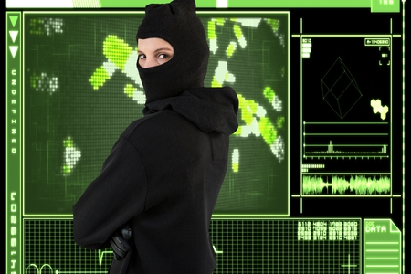 stealer: Digital composite of Hacker from back standing on a green interface