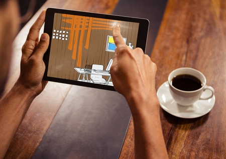 composite image: Digital composite of hands with tablet in a coffee shop. Tablet with office lines (brown, orange, blue and yellow)