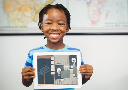 Digital composite of Boy smiling with tablet on his hands, showing the draw of the office on his tablet (color: dark blue