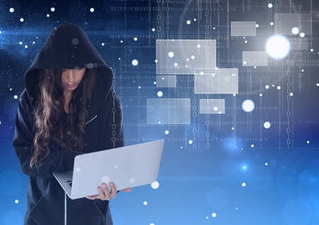 Digital composite of Woman hacker using a laptop in front of blue background
