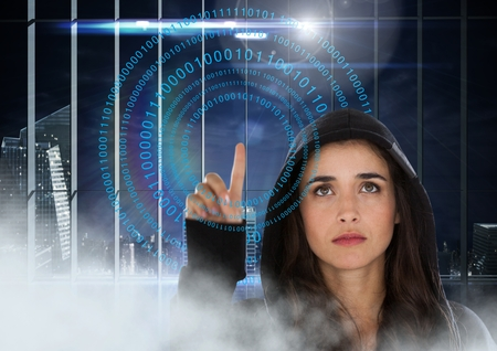 office theft: Digital composite of Woman hacker touching digital screens with her finger