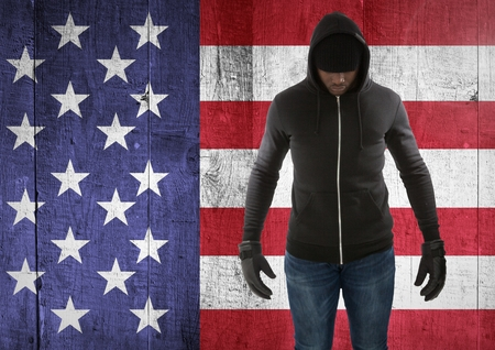 Digital composite of man with covered face against american flag Stock Photo