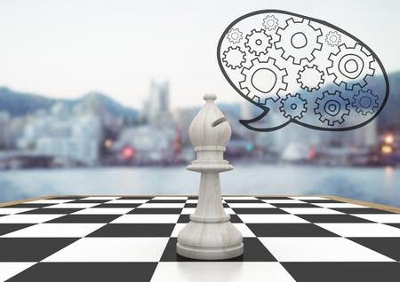 Digital composite of 3D Chess piece against blurry skyline and speech bubble with cogs Фото со стока