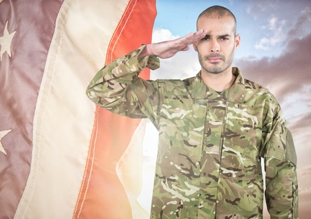 sergeant: Digital composite of Soldier saluting against a fluttering american flag