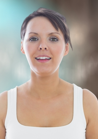 Digital composite of Woman in tank top against blurry blue brown background