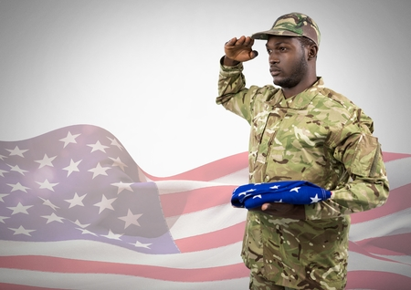 Digital composite of Black soldier holding an american flag for independence day against a 3d american flag Stock Photo