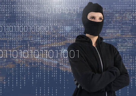 stealer: Digital composite of Woman hacker with hood standing on in front of blue digital background