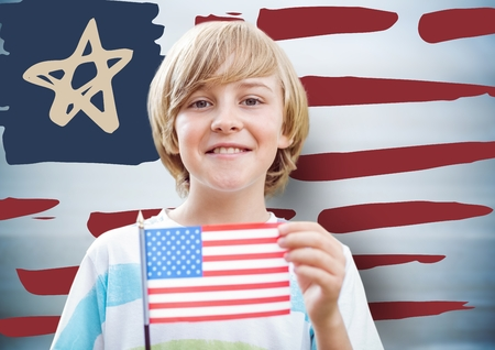 Digital composite of Boy holding american flag against hand drawn american flag and blurry blue background Stock Photo
