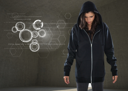stealer: Digital composite of Woman hacker standing on in front of grey background with digital graphics
