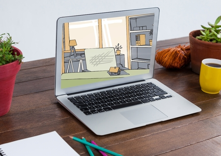 Digital composite of laptop with living room new design ( color: green, grey and beige). The laptop is on a desk with pla