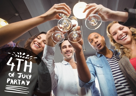 coworker: Digital composite of Black and white fourth of July party graphic against millennials toasting Stock Photo