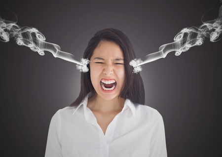 Digital composite of anger young businesswoman shouting with 3d steam on ears. Dark background