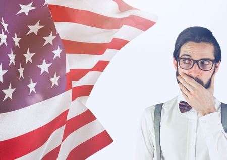 Digital composite of Surprised hipster man looking an american flag on his right 版權商用圖片