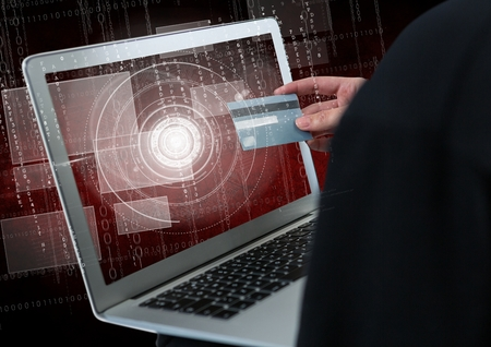 stealer: Digital composite of Close up of 3D hackers hand using a laptop while holding a credit card Stock Photo