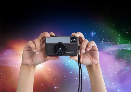photographing: Digital composite of Part of a photographer taking pictures in colored lights Stock Photo