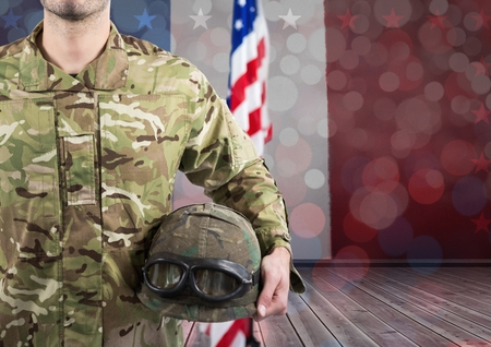Digital composite of Part of a soldier holding a helmet against an american flag background