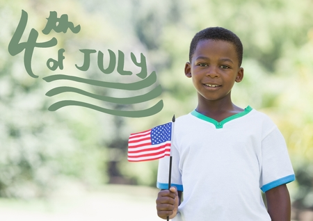 Digital composite of Green fourth of July graphic next to boy holding american flag Stock Photo
