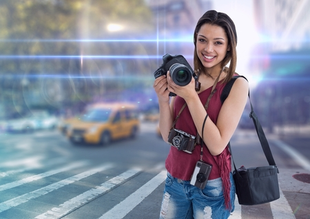Digital composite of happy young photographer on the 3d city with flares and lights everywhere