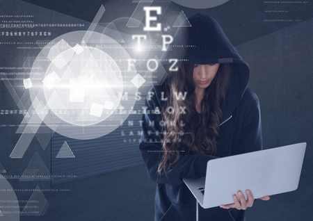 Digital composite of Woman hacker using a laptop in front of 3d digital background
