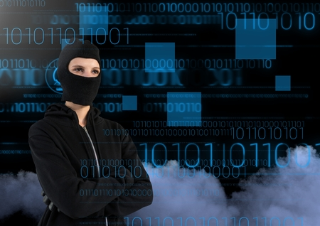 Digital composite of Woman hacker with arms crossed in front of 3d digital background Stock Photo