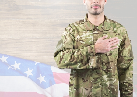 Digital composite of Part of a soldier putting his hand on heart against 3d independence day background