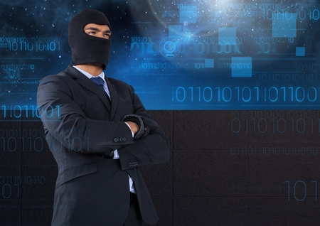 Digital composite of Business hacker with arms crossed in front of blue night sky