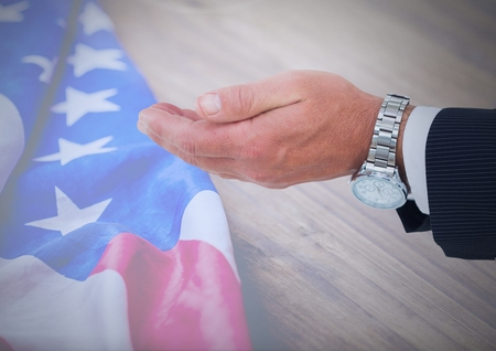 Digital composite of Cupping hands against american flag
